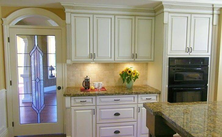 Antiqued Cream Kitchen Cabinets Traditional