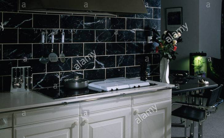 Black Wall Tiles Above White Fitted Units Modern