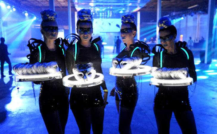 Futuristic Models Offered Masquerade Masks Guests