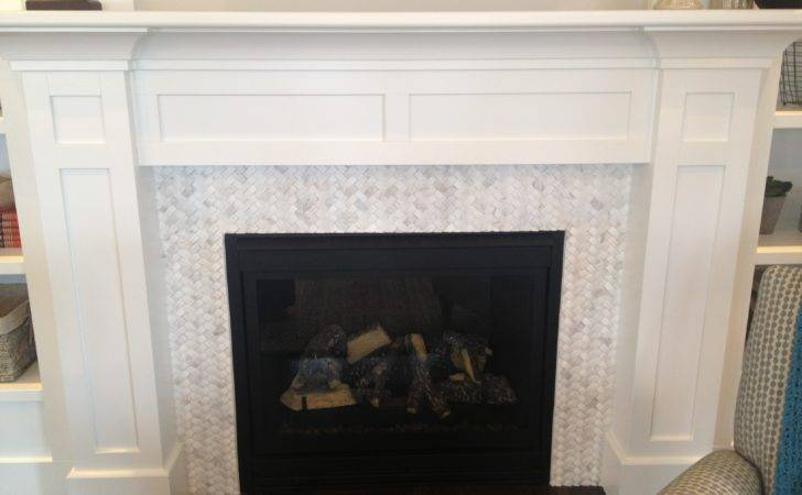 White Stained Wooden Fireplace Mantel Above Glass