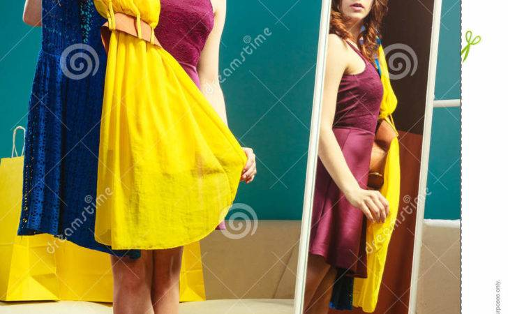 Woman Shopper Holds Hangers Clothes Looking Mirror
